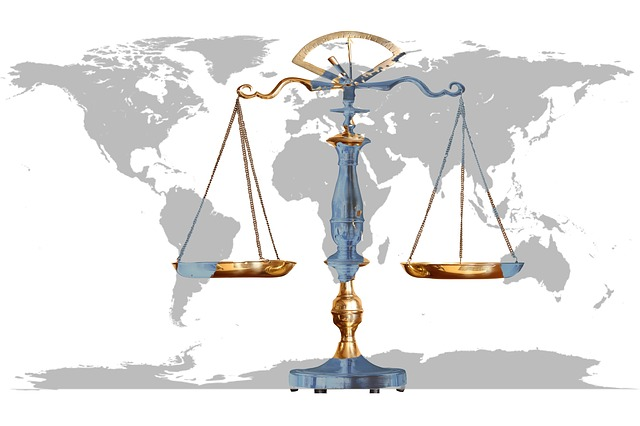 Scales justice on a world map background